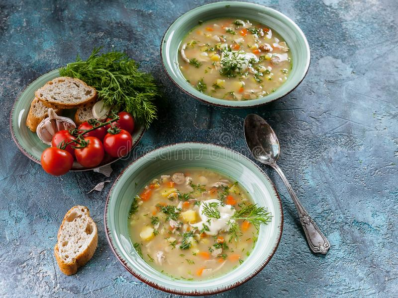 Pea soup with smoked meat, vegetables and greens. Delicious and healthy homemade food. Delicious and healthy homemade food. Pea soup with smoked meat, vegetables stock photos