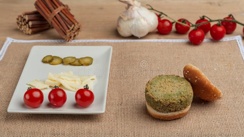 Pea vegan burgers. healthy food cherry tomatoes cheese and pickles royalty free stock photos
