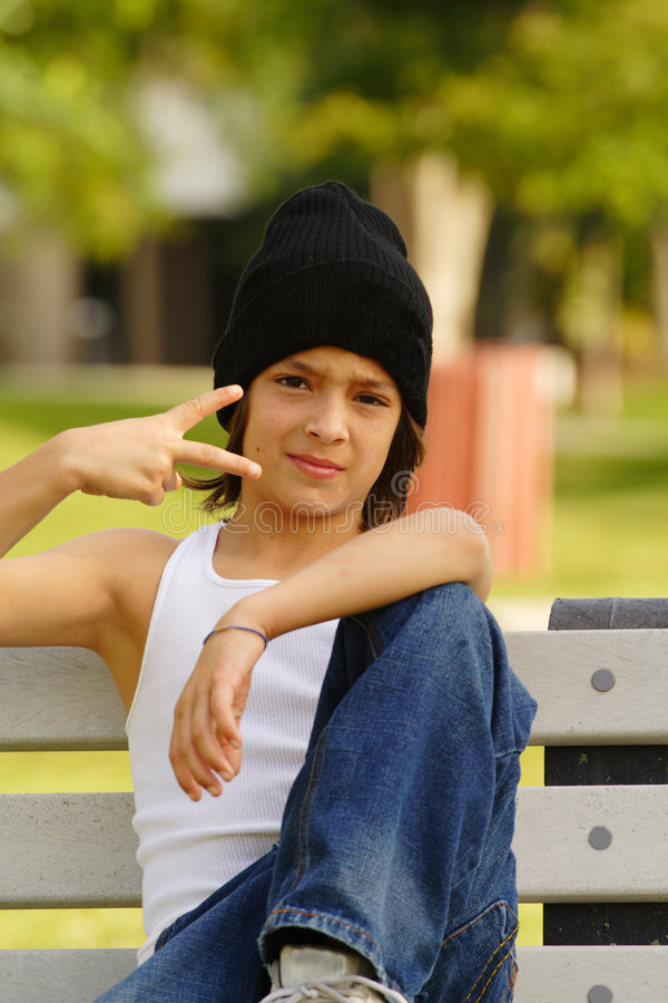 Peace. Young boy showing a sideways peace sign or could be some gang sign royalty free stock photo