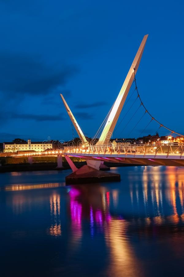 The Peace Bridge. Derry Londonderry. Northern Ireland. United Kingdom. The Peace Bridge over the river Foyle at night. Derry Londonderry. Northern Ireland royalty free stock image