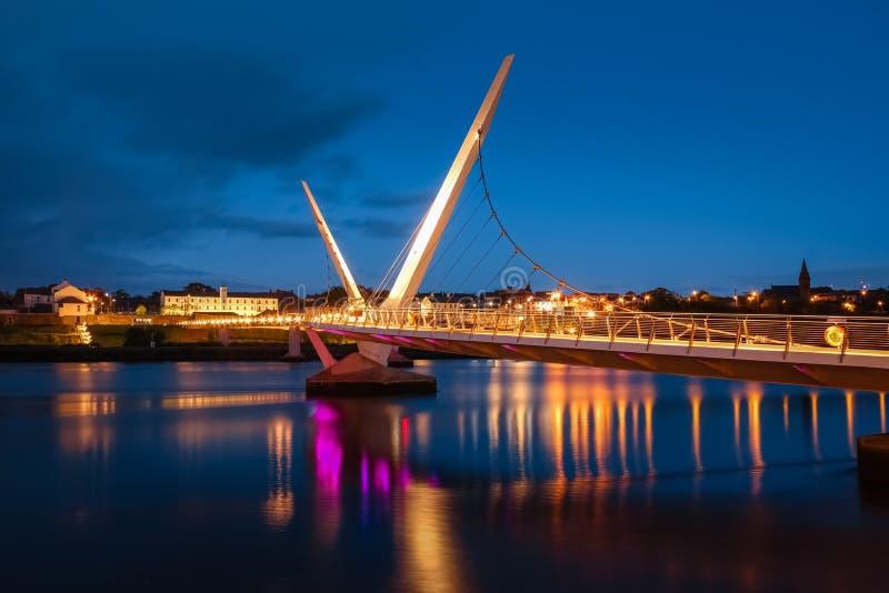 The Peace Bridge. Derry Londonderry. Northern Ireland. United Kingdom. The Peace Bridge over the river Foyle at night. Derry Londonderry. Northern Ireland stock photos