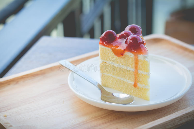 Peace of cherry cake served in afternoon time stock photography