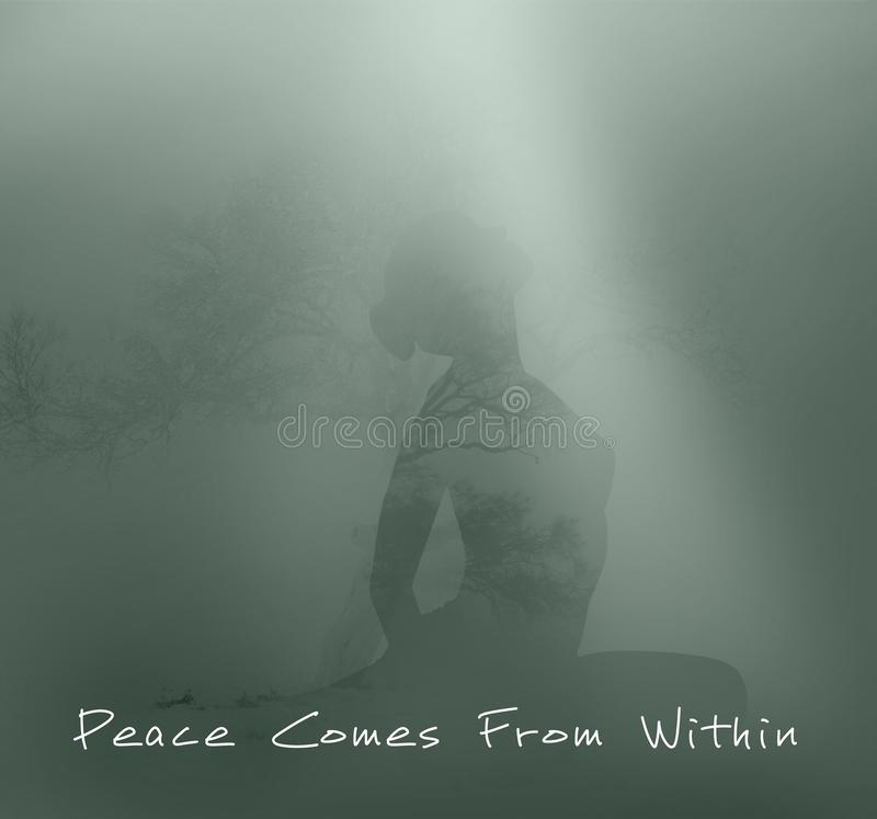 Peace come from within concept. With meditating female on background royalty free stock photo