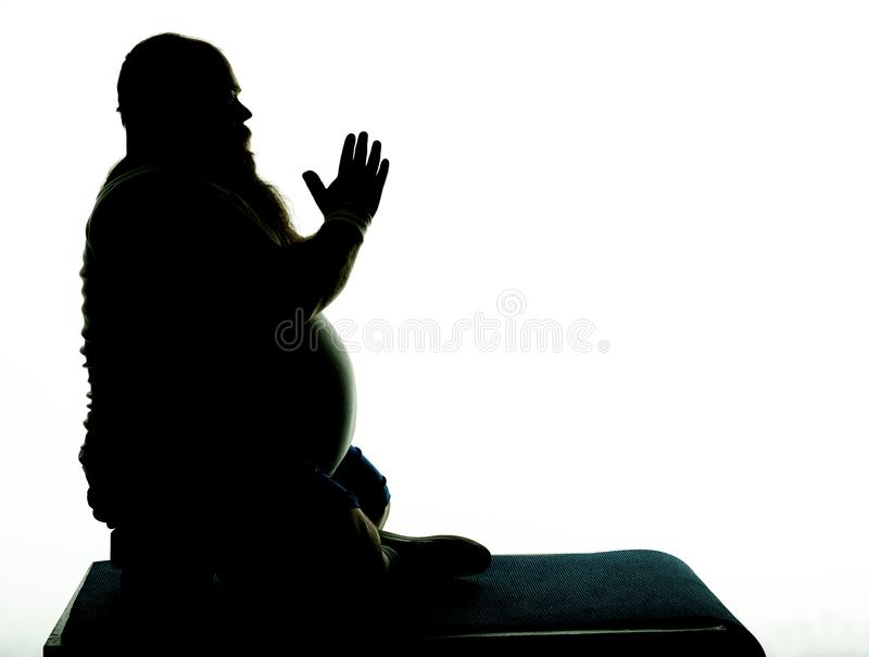 Tranquil thick guy meditating with serenity royalty free stock image