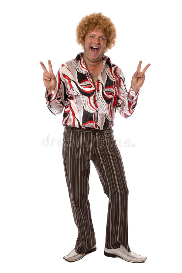 Peace Cool Dude. A man dressed in groovy seventies fashion giving a happy peace gesture, isolated on white stock photos