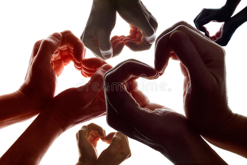 Peace on Earth. Various hands forming a symbol of love and peace