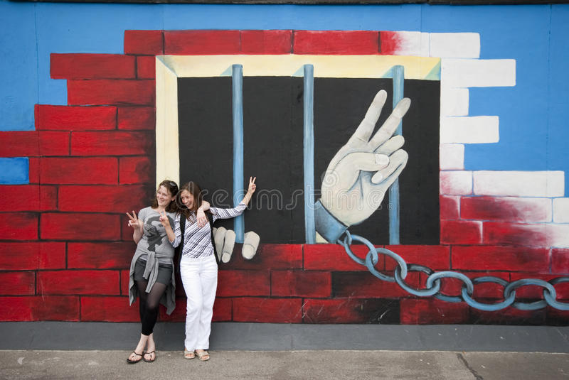 Peace fingers on Berlin Wall stock images