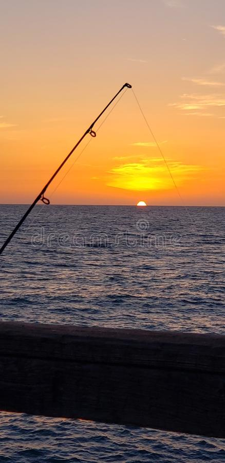 Peace. Fishing, alone, relax, sunset royalty free stock photo