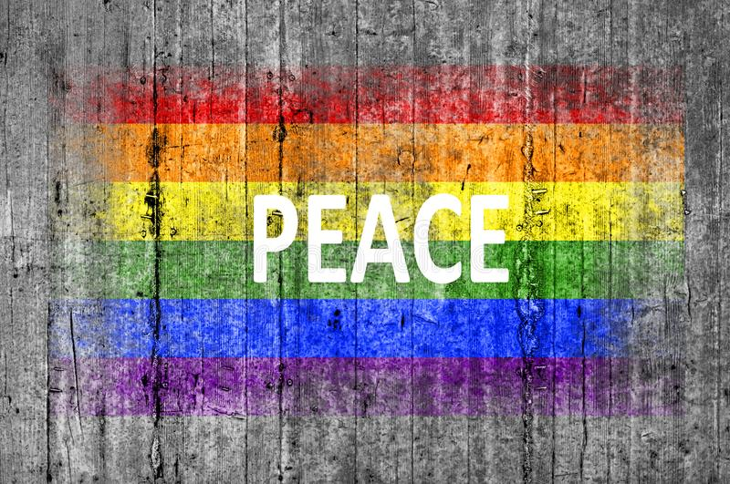 Peace and LGBT flag painted on background texture gray concrete stock photography