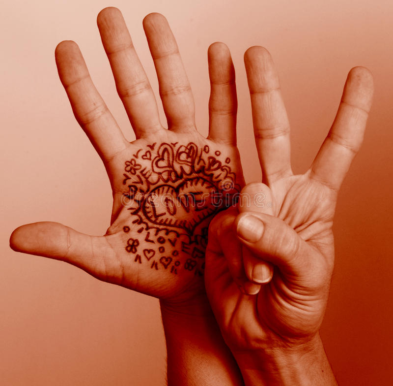 Peace love. Hands symbolizing love and peace in a photographic design royalty free stock images