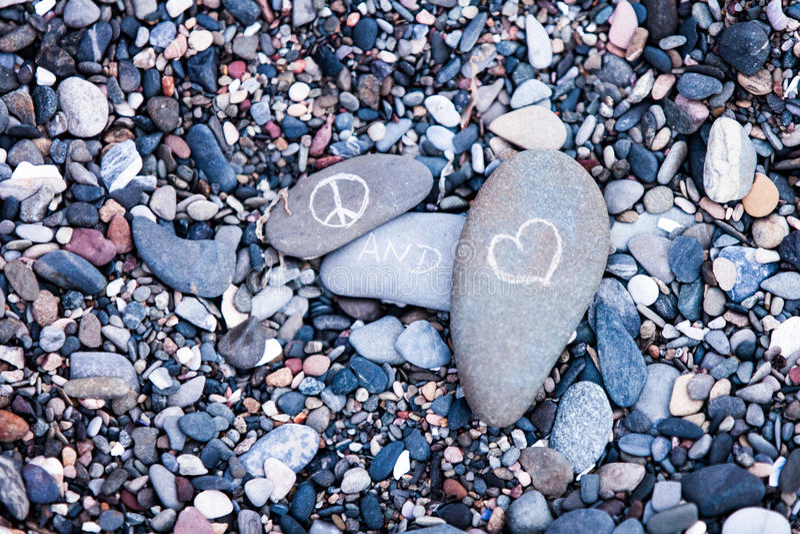 Peace and Love symbols on rocks stock photos