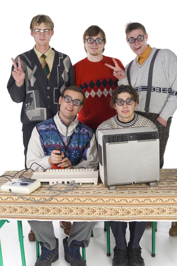 Peace man!. Five nerdy guys looking at camera and smiling. Two of them are sitting in front of old-fashioned computer. Others are standing behind them. They are royalty free stock image