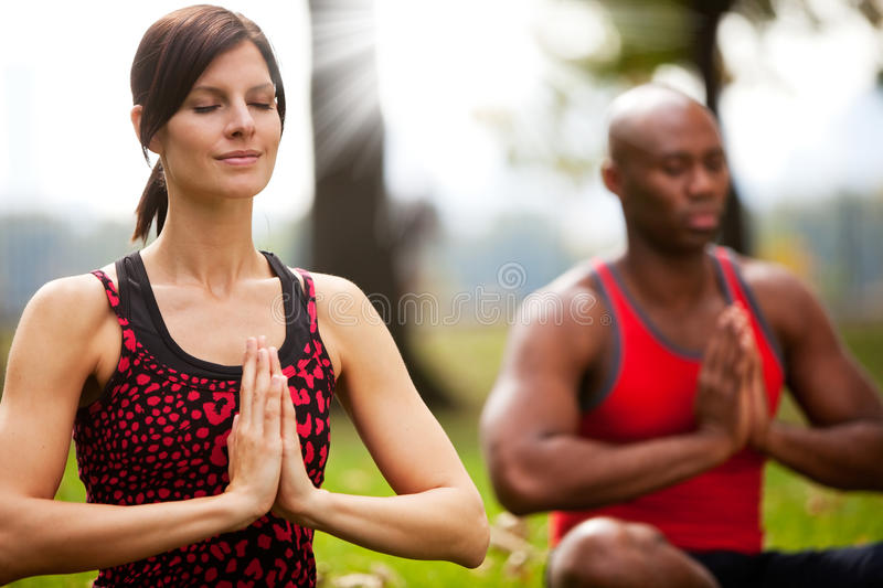 Peace Meditate. A group of people peacefully meditating in a park royalty free stock image