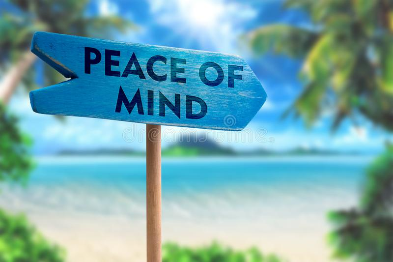 Peace of mind sign board arrow. On beach with sunshine background stock photography