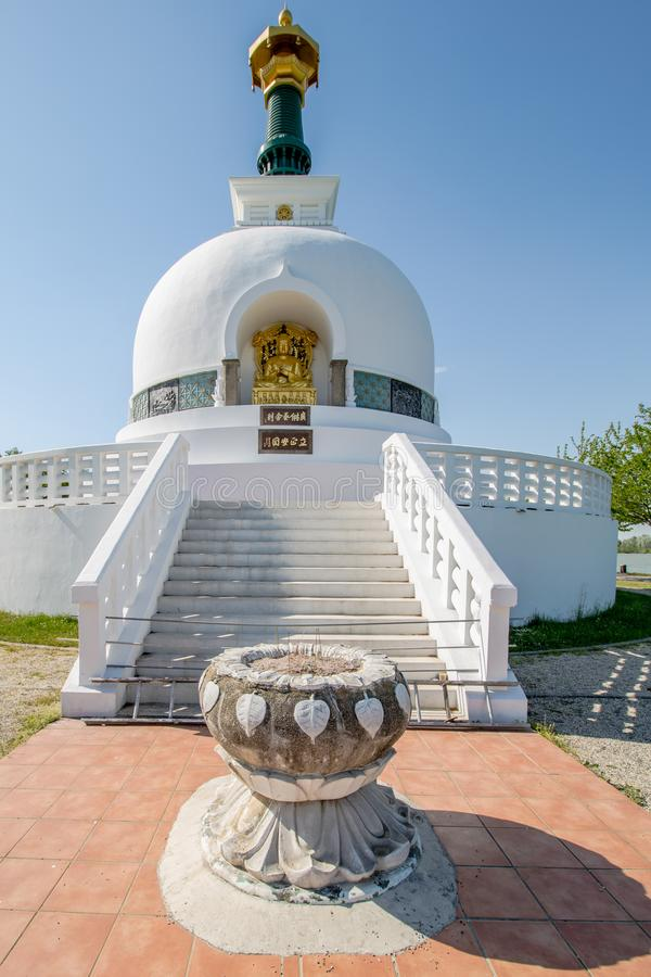 The Peace Pagoda on sunny spring day in Vienna, Austria. The Peace Pagoda Vienna is a Buddhist stupa located on the Danube in Vienna. It is one of around 80 stock images