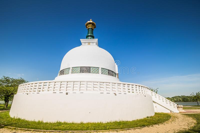 The Peace Pagoda on sunny spring day in Vienna, Austria. The Peace Pagoda Vienna is a Buddhist stupa located on the Danube in Vienna. It is one of around 80 royalty free stock photos