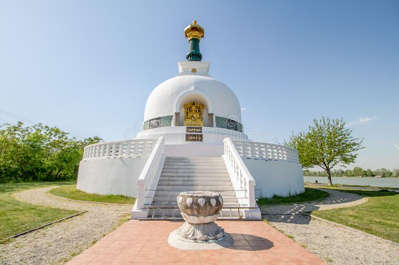 The Peace Pagoda on sunny spring day in Vienna, Austria. The Peace Pagoda Vienna is a Buddhist stupa located on the Danube in Vienna. It is one of around 80 stock photos