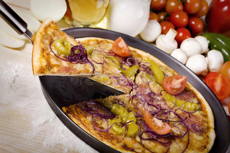 Download Peace Of Pizza And Components Stock Photo - Image of meal, pepper: 12186122