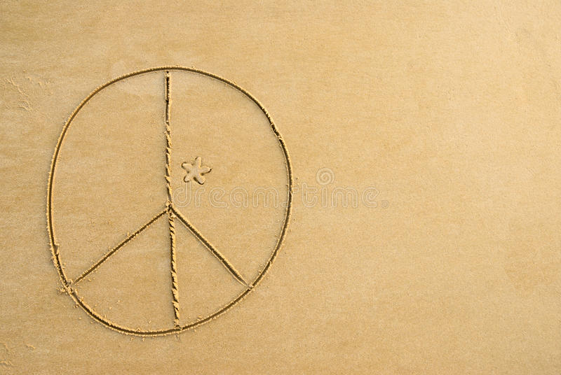 Peace sign. A peace sign written on the beach stock image