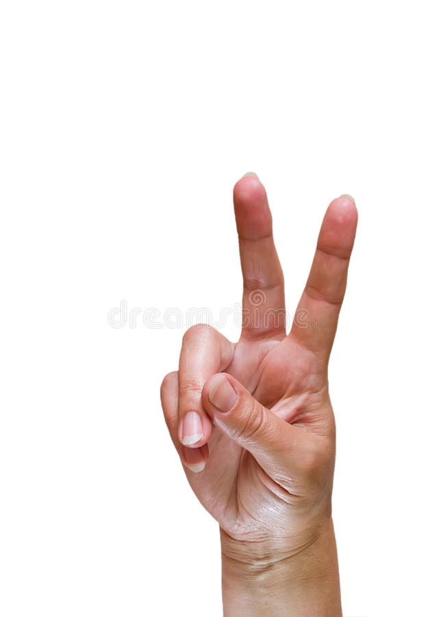 Peace sign. Mature female hand doing peace sign on white background royalty free stock images