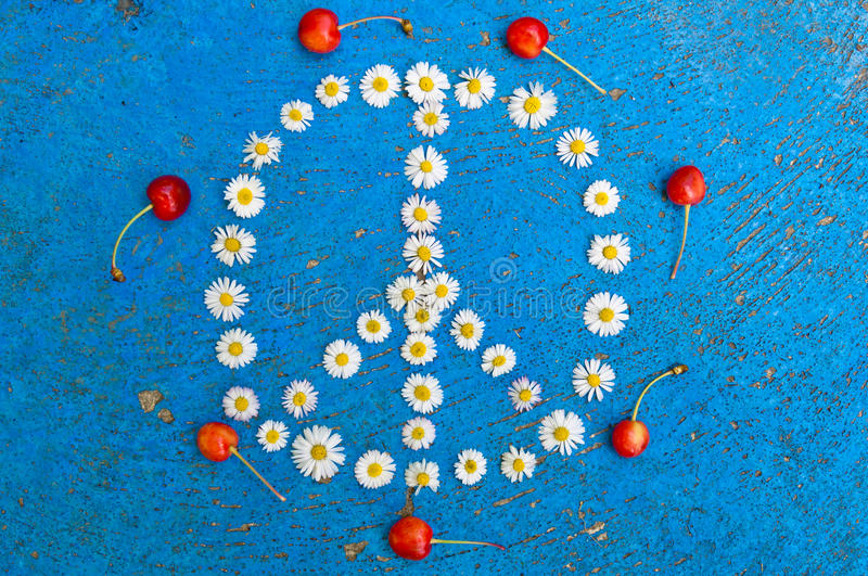 Peace sign peace symbol peace design on blue background. Peace sign, peace symbol, peace design created of daisy flowers on textured blue background stock image