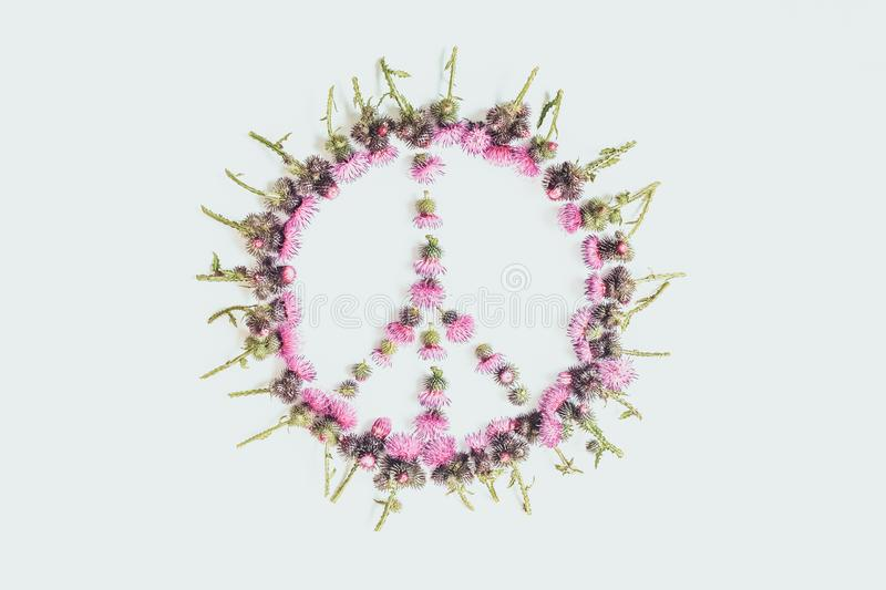 Peace sign - a symbol of peace, disarmament and anti-war movement, lined with delicate pink flowers. Peace sign Pacific-a symbol of peace, disarmament and anti stock images