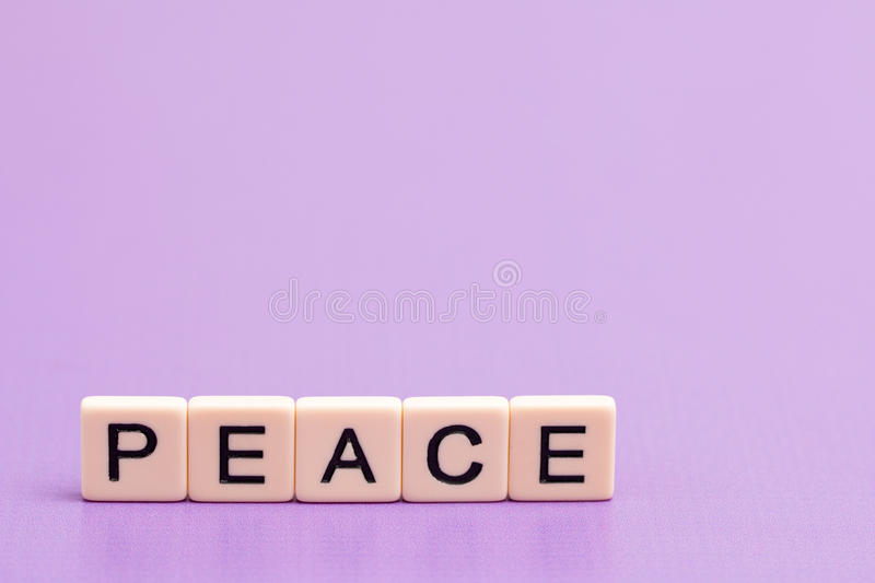 Peace Spelled out. In Tiles stock images
