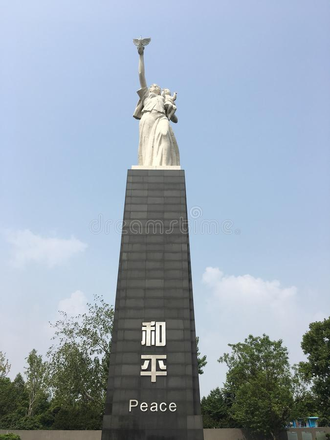 Peace statue in Nanjing massacre museum, China. Peace statue bottom view, The Memorial Hall of The Victims in Nanjing Massacre by Japanese Invaders stock images