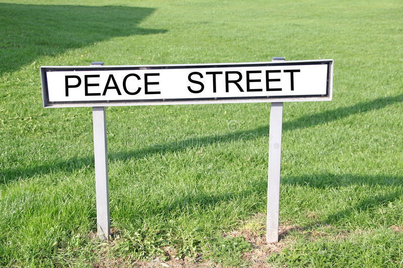 Peace street sign. Photo of peace street road sign on grass verge stock image