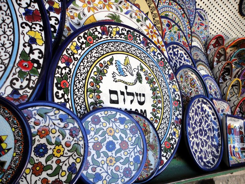 Peace Symbol on a Dish. Peace or Hebrew Shalom Symbol on a Ceramic Dish with a Dove holding an Olive Branch in the center. A Jerusalem Merchant displaying his royalty free stock photos