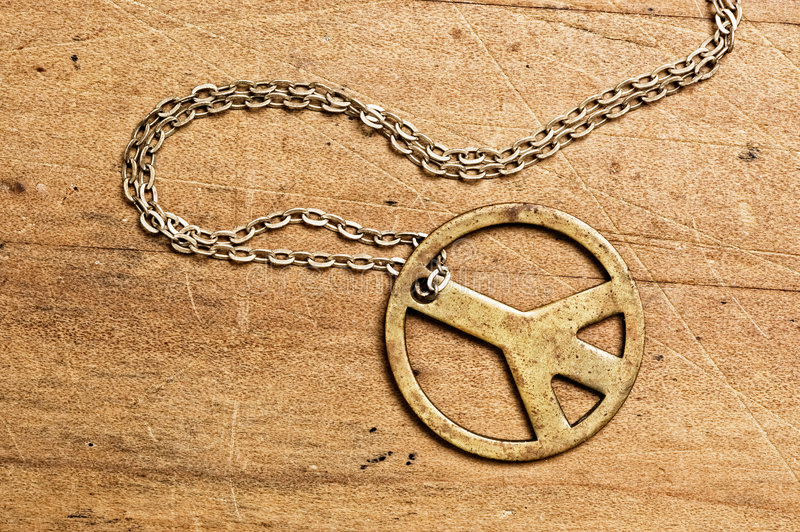 Peace symbol necklace. stock photography