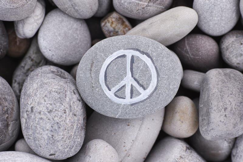 Peace symbol on stone stock photo