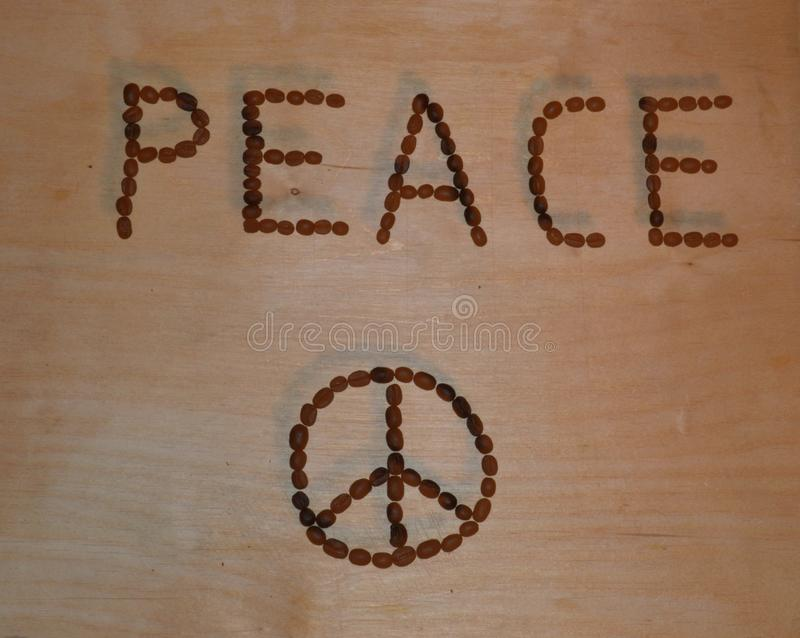 Peace title and icon on wooden table with 3D shade effect. stock photo