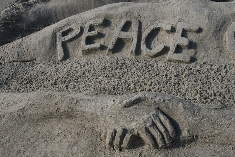Peace to the World. Peace is spelled out in the sand at the beach royalty free stock photography