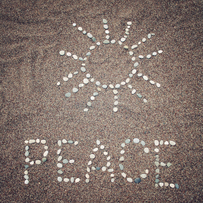 Free Peace Word And Sun Symbol On The Sand - Toned Photo. Stock Photography - 54046182
