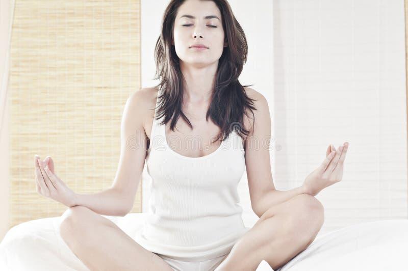 Peace through yoga royalty free stock image