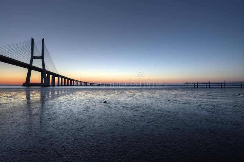 Blue hour at Vasco de Gama Bridge in Lisbon. Ponte Vasco de Gama, Lisboa, Portugal. Peaceful atmosphere at Vasco de Gama Bridge in Lisbon during sunrise. Ponte royalty free stock photos