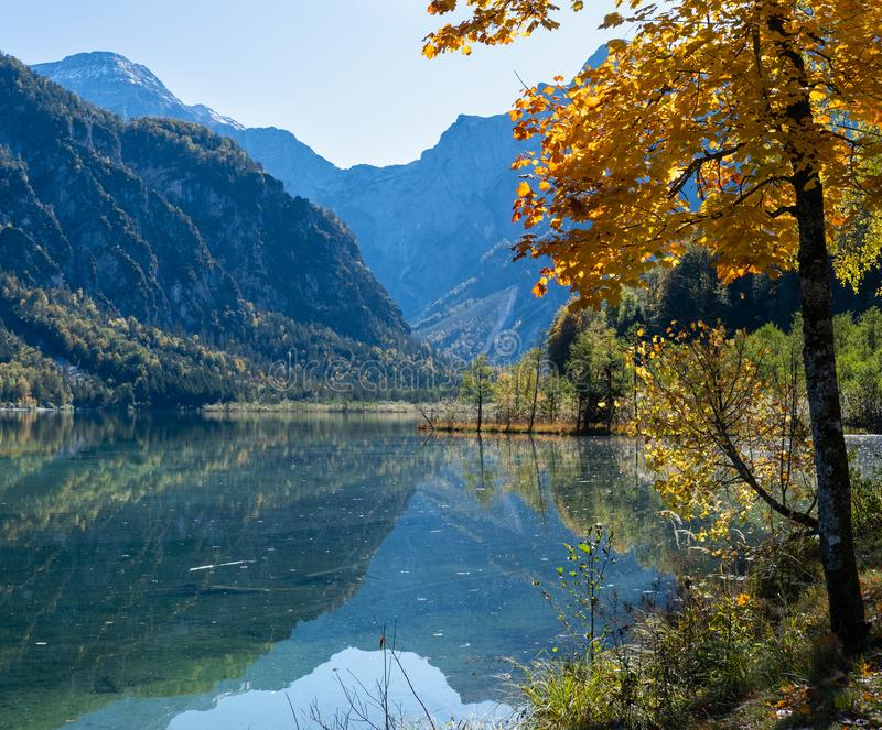 Peaceful autumn Alps mountain lake with clear transparent water and reflections. Almsee lake, Upper Austria stock image