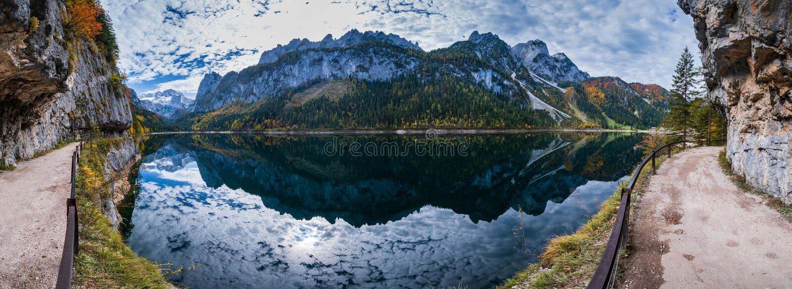 Peaceful autumn Alps mountain lake with clear transparent water and reflections. Gosauseen or Vorderer Gosausee lake, Upper. Sunny idyllic colorful autumn alpine stock photos