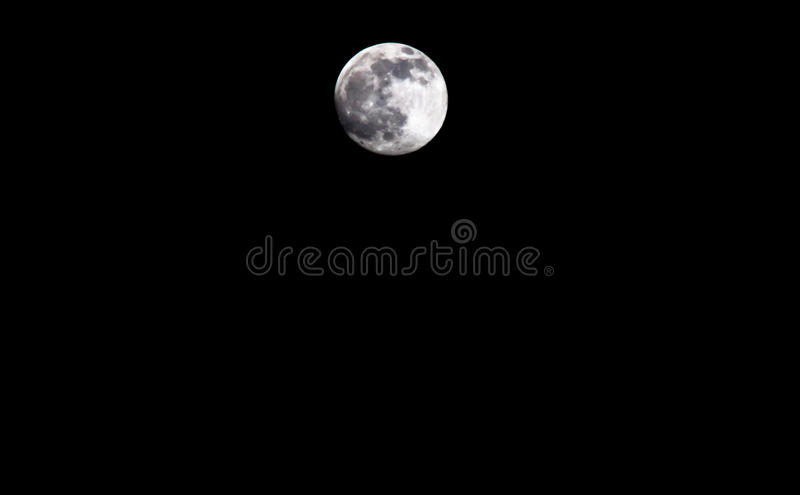 Peaceful background, dark night sky with full moon, royalty free stock image