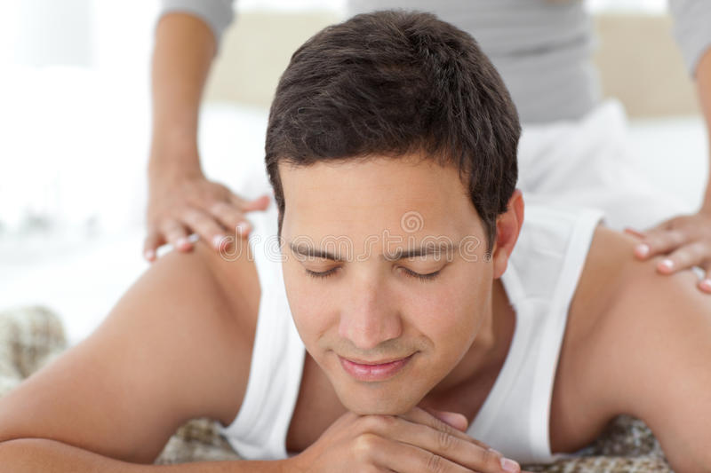 Peaceful being massaged by his girlfriend royalty free stock photos