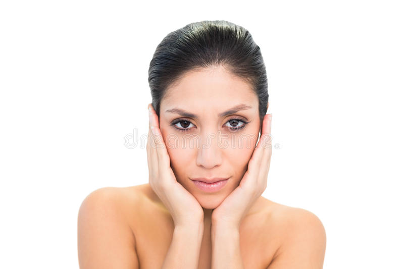Peaceful Brunette Touching Her Face With Both Hands Stock Photography
