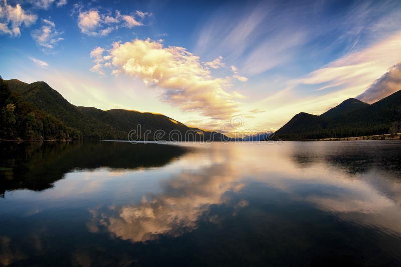 Peaceful and calming image of a lake and dramatic clouds stock image