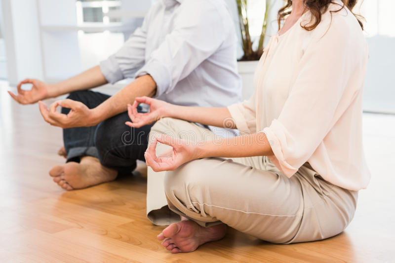 Peaceful casual business colleagues meditating royalty free stock photos