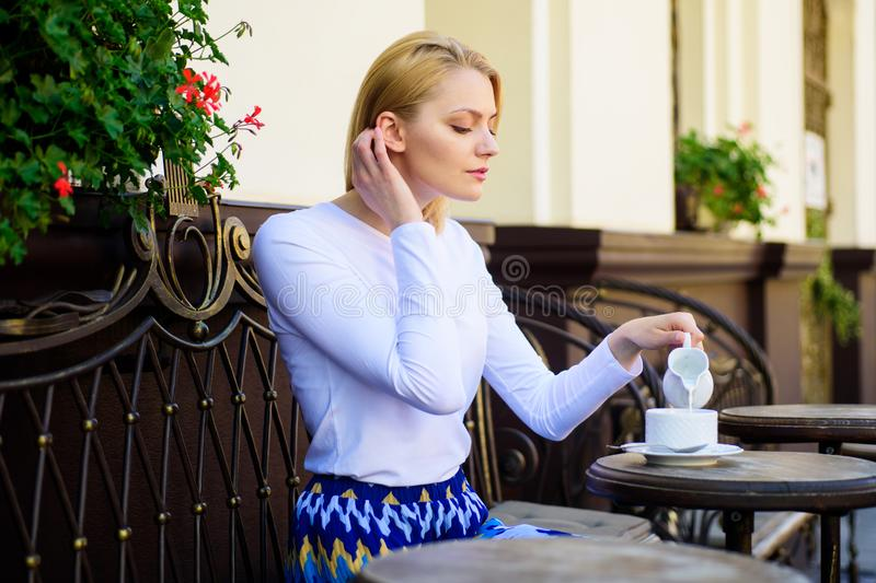 Peaceful coffee break. Woman elegant calm face have drink cafe terrace outdoors. Mug of good coffee in morning gives me. Energy charge. Girl drink coffee every stock photo