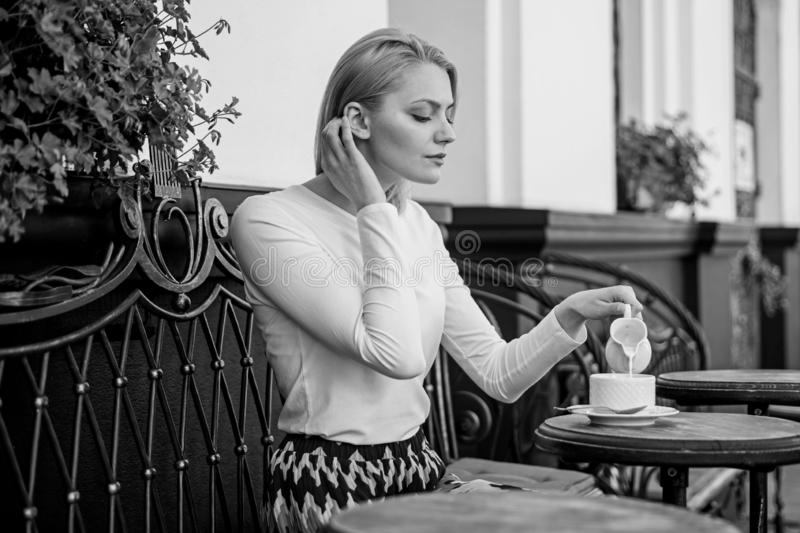Peaceful coffee break. Woman elegant calm face have drink cafe terrace outdoors. Mug of good coffee in morning gives me. Energy charge. Girl drink coffee every royalty free stock photography