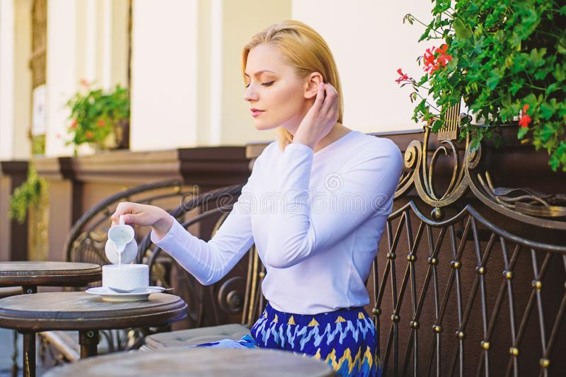 Peaceful coffee break. Woman elegant calm face have drink cafe terrace outdoors. Mug of good coffee in morning gives me. Energy charge. Girl drink coffee every royalty free stock photo