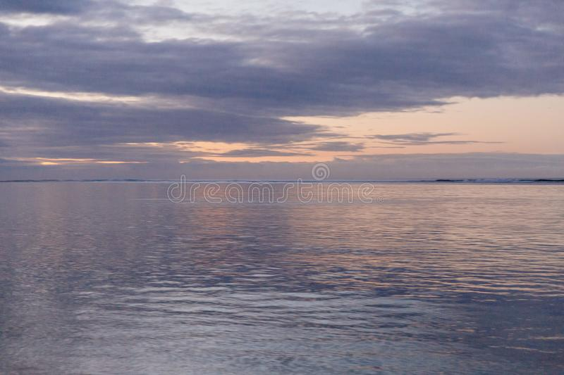 Peaceful dawn over the ocean stock photography