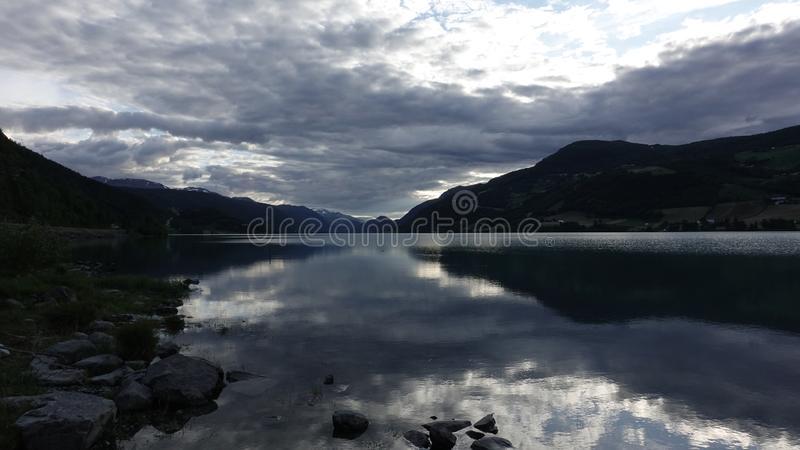 Peaceful evening at the lake in Norway stock photography
