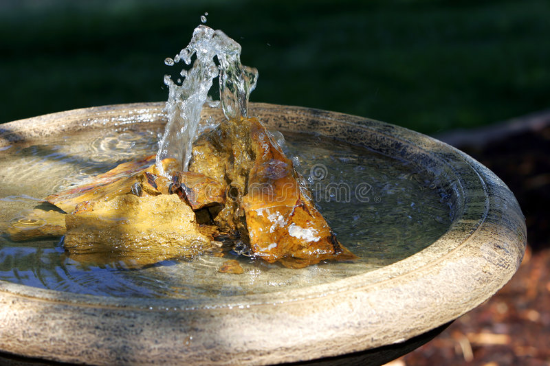 Peaceful Fountain, Rocks, & Basin royalty free stock image